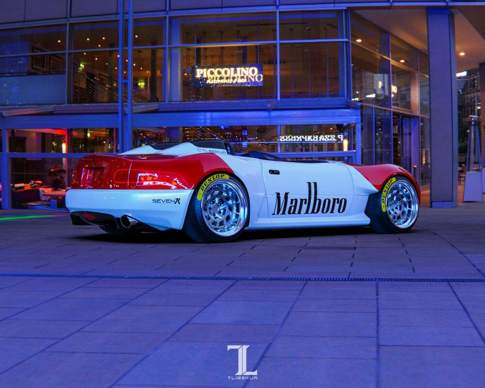 次期新型マツダ・ロードスター「NE型」スピードスター 予想CG サイド/リア 背景ブルー