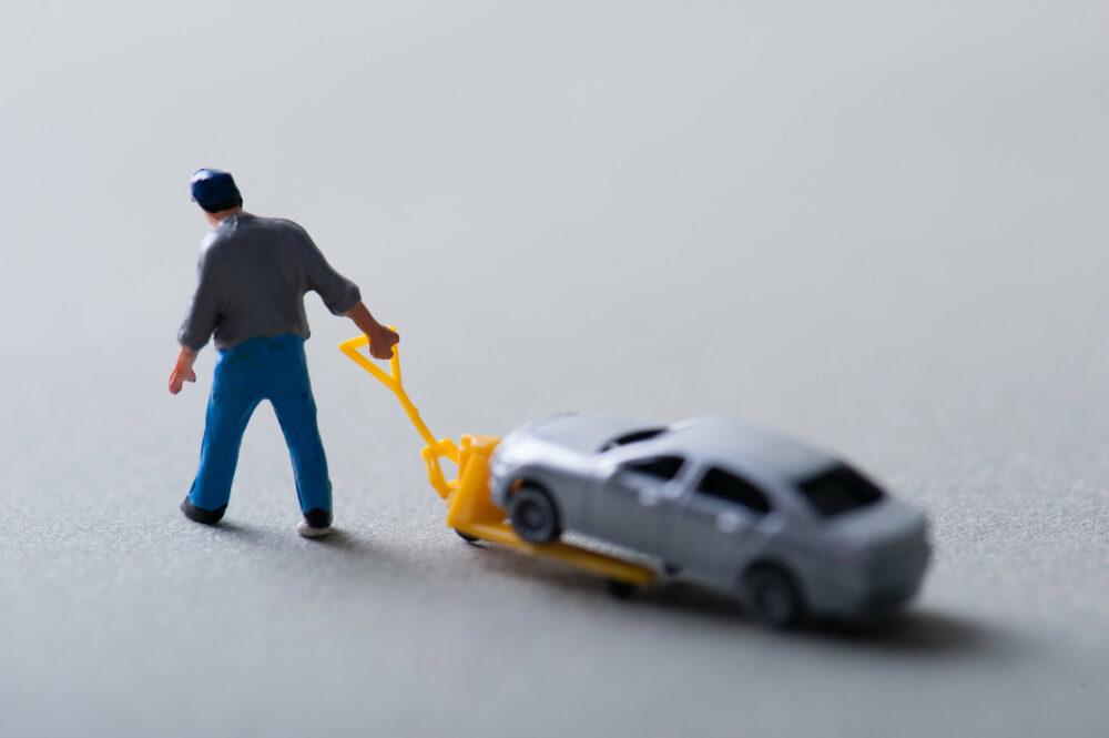 車を引く人形