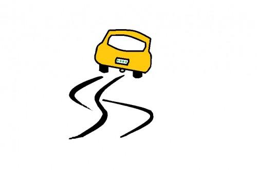 蛇行する車