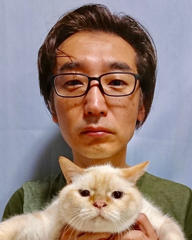 武藤と猫の証明写真